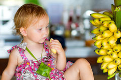 Outdoor portrait of toddler girl with bananas Royalty Free Stock Images