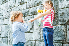 Outdoor portrait of two adorable children Stock Photography