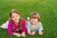 Outdoor portrait of two adorable kids Stock Photos