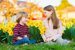 Outdoor portrait of two adorable kids Stock Image