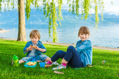 Outdoor portrait of two adorable kids Royalty Free Stock Photography