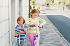 Outdoor portrait of two adorable kids Stock Photography