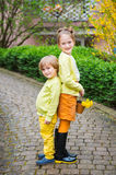 Outdoor portrait of two adorable kids Stock Photo