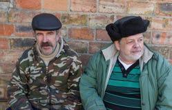 Outdoor portrait  of two elderly Ukrainian peasan Stock Photography