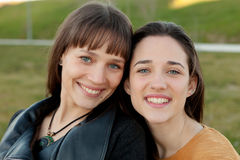 Outdoor portrait of two happy sisters Stock Photos