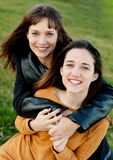 Outdoor portrait of two happy sisters Stock Images