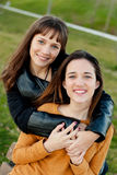 Outdoor portrait of two happy sisters Stock Photo