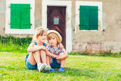Outdoor portrait of two kids Royalty Free Stock Image