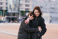 Outdoor portrait of two stylishly dressed, beautiful girls and very happy. Girlfriends walking and it is very fun. Royalty Free Stock Image