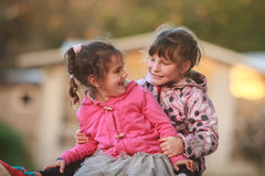 Outdoor portrait of two young happy children, girls - sisters - Royalty Free Stock Images