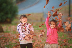 Outdoor portrait of two young happy children, girls - sisters - Stock Images