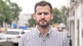 Outdoor Portrait of Upset Beard Casual Man stock video