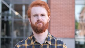 Outdoor Portrait of Upset Redhead Beard Young Man. 4k high quality, 4k high quality stock video