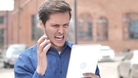 Outdoor Portrait of Upset Young Man Using Tablet. 4k high quality, 4k high quality stock video footage