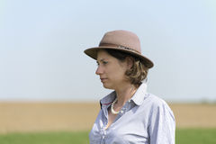 Outdoor portrait of woman with hat. Blue sky Stock Images