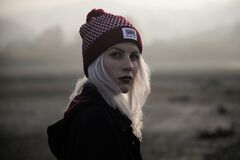 Outdoor portrait of woman in knit hat
