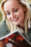 Outdoor Portrait Of Woman Reading Magazin Royalty Free Stock Photography