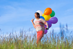 Outdoor portrait of a young African American teenage girl runnin Stock Images
