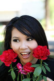 Outdoor portrait young asian american woman rose Stock Images