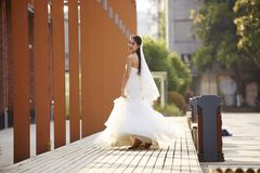 Outdoor portrait of asian bride. Outdoor portrait of young and beautiful asian bride with bouquet in hand Stock Photo