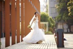Outdoor portrait of asian bride Stock Photo