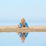 Girl training on beach Royalty Free Stock Image