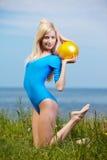Blonde girl gymnast outdoors Stock Photo