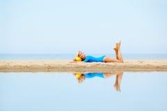 Girl training on beach Stock Photo