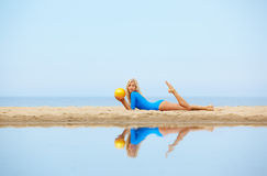 Girl training on beach Royalty Free Stock Photography