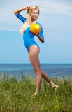 Blonde girl gymnast outdoors Royalty Free Stock Images