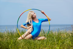 Blonde girl gymnast outdoors Royalty Free Stock Photo