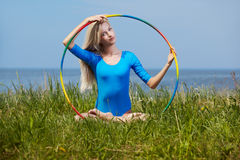 Blonde girl gymnast outdoors Royalty Free Stock Image
