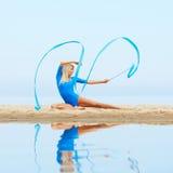Girl training on beach Stock Photography