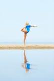 Girl training on beach Stock Images