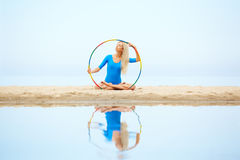 Girl training on beach Royalty Free Stock Photos