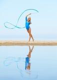 Girl training on beach Stock Image