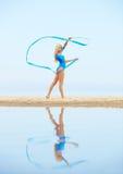 Girl training on beach Royalty Free Stock Photos