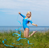 Blonde girl gymnast outdoors Royalty Free Stock Photography