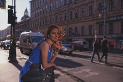 Outdoor portrait of young beautiful caucasian woman walks on street in St.Petersburg, Russia Royalty Free Stock Photos