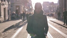 Outdoor portrait of young beautiful fashionable brunette woman walking on the street at autumn. Model wearing stylish stock footage