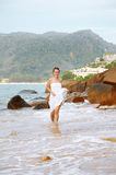 Girl running in waves Stock Photo