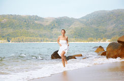 Girl running in waves Royalty Free Stock Image