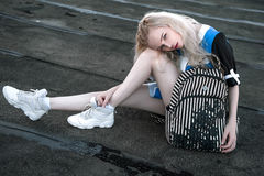 Outdoor portrait of young beautiful happy blond european lady posing on street. Model wearing stylish clothes.. Female fashion. Ci royalty free stock photography