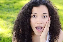 Young latin woman with surprised facial expression. Stock Image