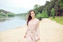 Outdoor portrait of young beautiful smiling woman Stock Image