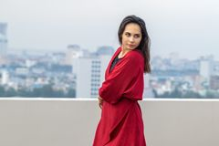 Outdoor portrait of young beautiful woman dancing on the rooftop royalty free stock photo