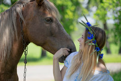 Outdoor portrait of young beautiful woman with horse.  Stock Photos