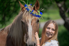Outdoor portrait of young beautiful woman with horse.  Royalty Free Stock Image