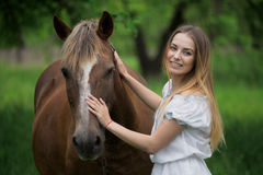 Outdoor portrait of young beautiful woman with horse.  Stock Image