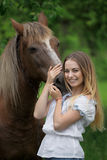 Outdoor portrait of young beautiful woman with horse.  Royalty Free Stock Images